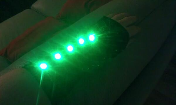 Action shot of LEDs on, showing green, washing out the camera lens