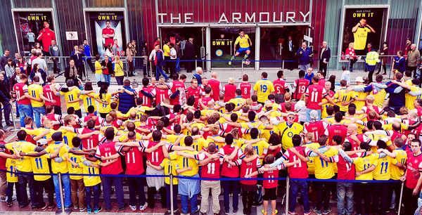 A massive pack of Arsenal fans with Ozil shirts have their picture taken before the Stoke game