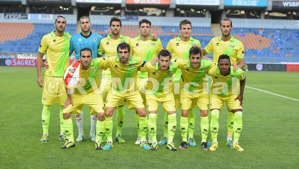 Rayo Vallecano playing in their lemon and lime strip v Valencia