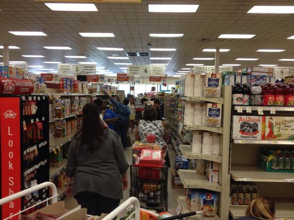Scene at 1/2 off sale at Piggly Wiggly. Checkout lines go to the back of the store and across back isle http://twitter.com/BCmeansBigCity/status/384711667315388416/photo/1
