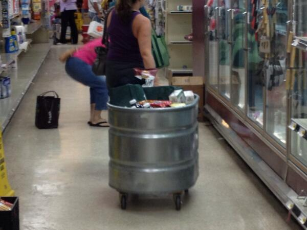 At #PigglyWiggly 1/2 off sale. Shoppers using store fixtures as carts http://twitter.com/BCmeansBigCity/status/384712274608680960/photo/1