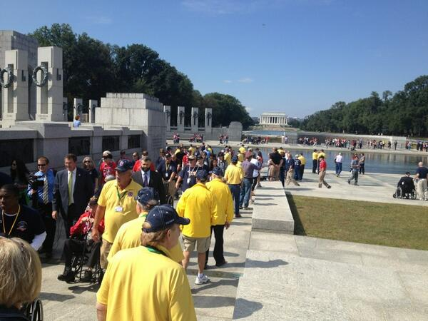 Iowa vets (yellow shirts) now coming into WWII memorial with congressional security guard. #shutdown http://twitter.com/LeoShane/status/385073703072972801/photo/1