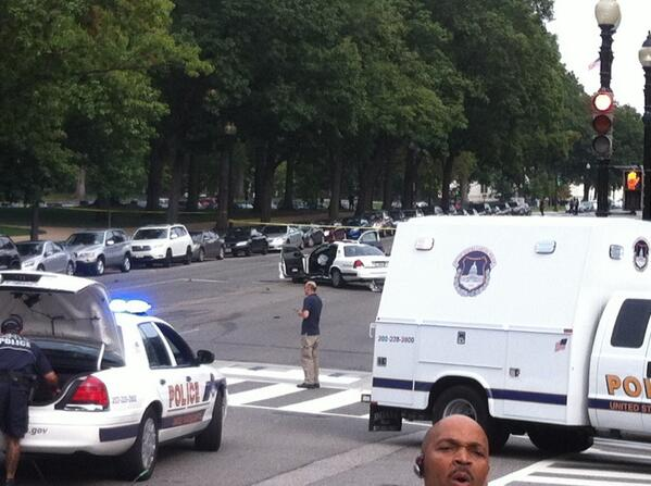At the Capital following shooting. In front of smashed police car. http://t.co/zzfKxwLY7H
