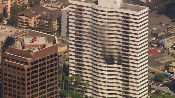 Photo fire burns inside barrington plaza apartment for Highrise apartments in los angeles