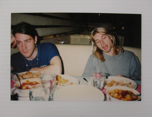 Photo of Kurt Cobain and Chad Channing at a meal during their 1990 US tour. See it in person: http://t.co/ycfcleni9Z http://t.co/8Vpc5Kkkql