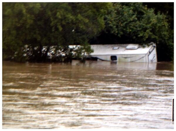 Submerged trailer home in Onion Creek near E Slaughter Lane. No occupants. #flooding #statesman http://twitter.com/RalphBarrera/status/389479846767652864/photo/1