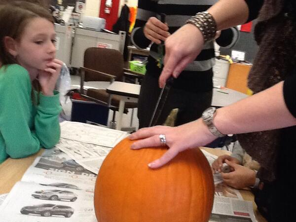 Mrs.Wideen cut open our pumpkin and my whole group is taking out seeds! http://t.co/zNyxsHKzHA