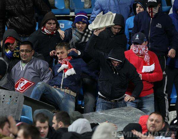 Fans brandish a Nazi flag with a swastika at the Shinnik Yaroslavl v Spartak Moscow match [Shocking Pictures]