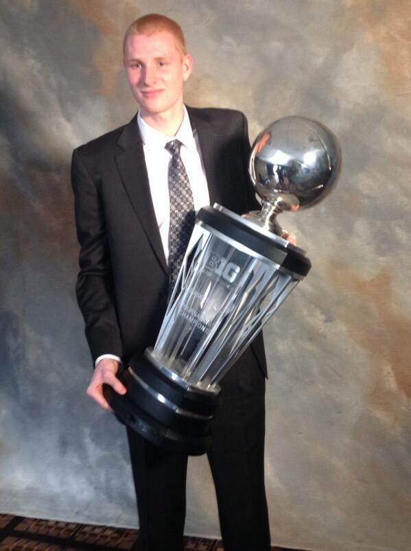 Junior @Aaron_White30 holds the B1G Tournament trophy at #B1GMediaDay. #Hawkeyes http://t.co/RfLxdWLm8p