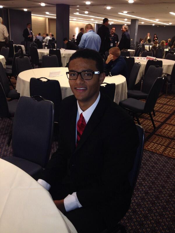 Shavon Shields is a candidate for best dressed @ #B1GMediaDay. Pinstripe suit, Nebraska Red tie and hipster glasses. http://t.co/mFGGKyZBPg