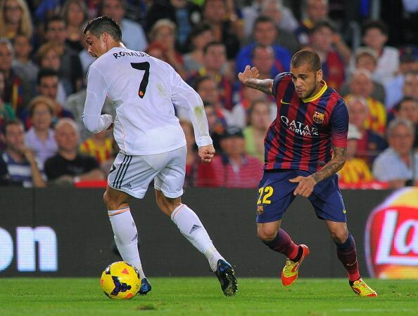 One of the all time great nutmegs! Dani Alves pokes the ball through legs of Cristiano Ronaldo