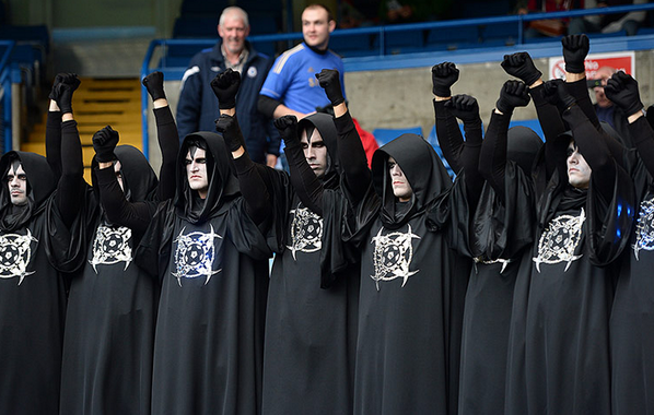 BXmQGFgIUAAuJFk So Scary! After appearing at Bayern on Saturday, 11 men dressed in identical black robes turn up at Chelsea [Pictures]