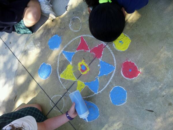 3rd graders celebrate Diwali by creating rangolis with colored sand. http://t.co/MVTss68abj
