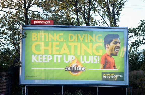 "Banner of Liverpools Luis Suarez by the Emirates: ""Biting, diving, cheating, keep it up Luis!"" [Picture]"