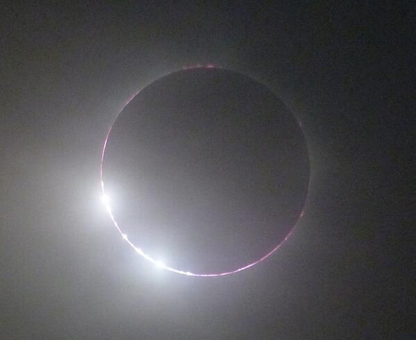 Total #eclipse success in western #Uganda 1 3/4 hours ago! Seen thru thin cloud which we outran partially in our car. http://twitter.com/cosmos4u/status/397032077742206978/photo/1