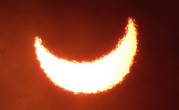 Final view of the short (11 s at our site) but extremely beautiful #eclipse in #Uganda: second partiality thru smoke. http://twitter.com/cosmos4u/status/397034912483536896/photo/1