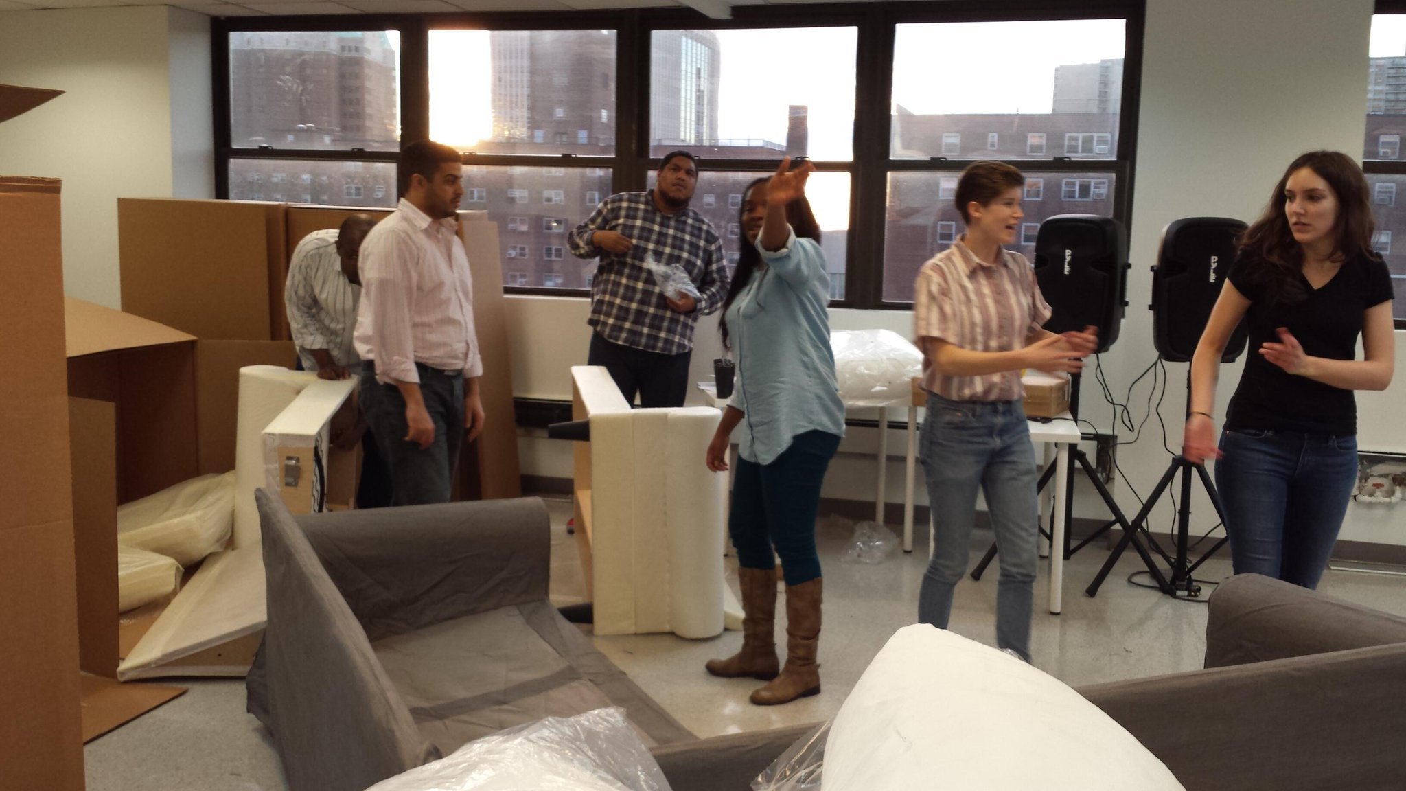 Photo of Flatiron students building Ikea couches