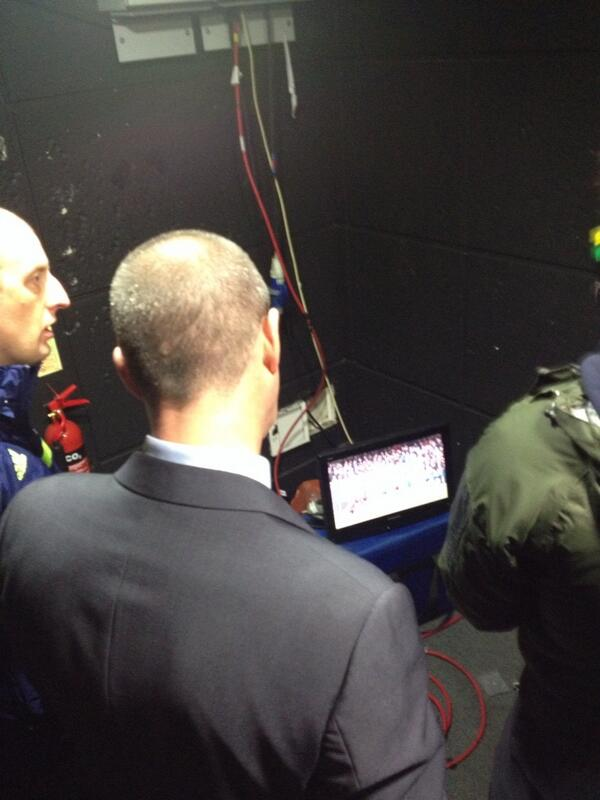 West Brom manager Steve Clarke watches replay of the Ramires penalty before doing MOTD interview
