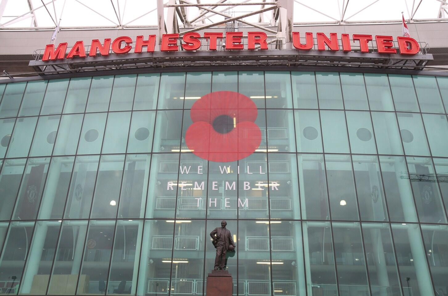Manchester United put a large poppy on Old Trafford with the message We Will Remember Them