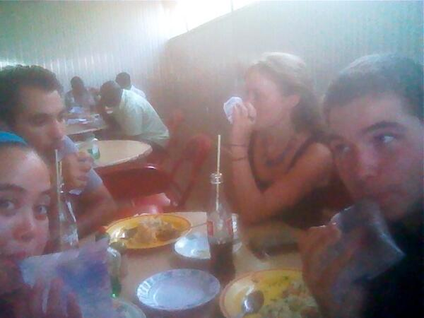 Took a lunch break with fellow interns. Drank water from plastic bags and and had Ghanaian food. #lifeinghana http://t.co/t2IpBYMZlj