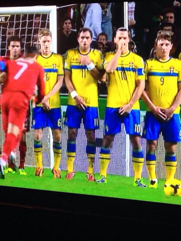 LOLZ! Zlatan Ibrahimovic protects his nose in the wall for a Cristiano Ronaldo free kick