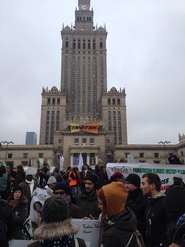 Big crowd for the #Cop19 climate justice march--and a dramatic backdrop: http://t.co/LcVQIQzHJ4