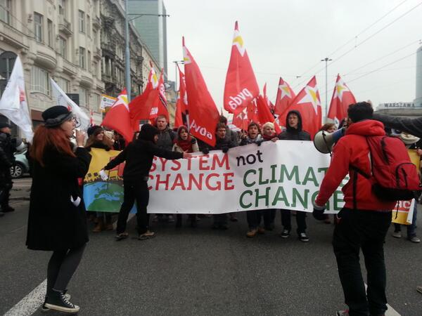 """Change the system, not the #climate"" protestors in Warsaw at #COP19 http://t.co/eK5Ncov54Z"