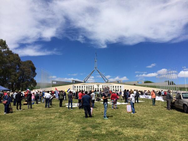 Protesters gathering outside Parliament to demand Abbott stop denying refugees human rights #refugeeaction http://t.co/2qFU3rty6P