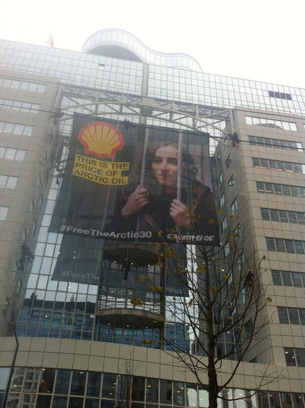 NOW: banner with #Arctic30 Faiza's face on the side of Shell building in Rotterdam h/t @GreenpeaceNL #FreeTheArctic30 http://t.co/Z96XfFVLvQ