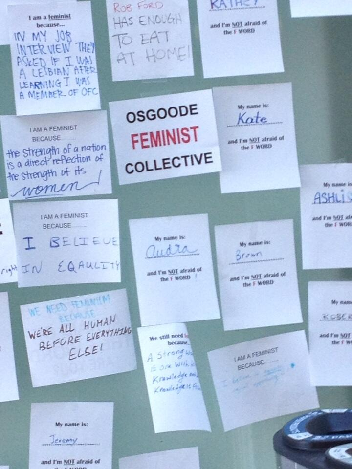 "photo of posters describing ""why i am a feminist"" up at the law school"