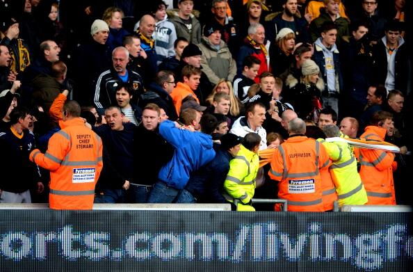 Scenes! Hull fans clash with stewards after having their harmless banner taken [Pictures]