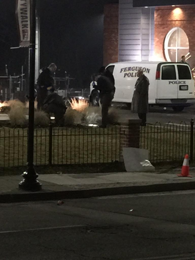 Police also searching for evidence in garden area next to the #Ferguson police station. http://t.co/zlNQCXIjVm