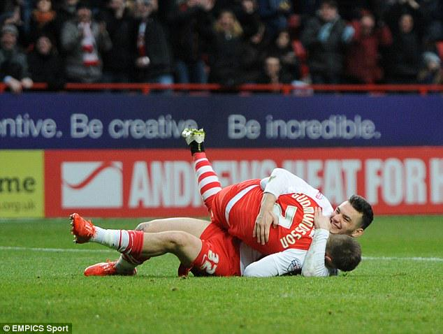 Tony Watt and Johann Berg Gudmundsson embrace in the centre circle. It's catching on #cafc http://t.co/gmr92rVDQV