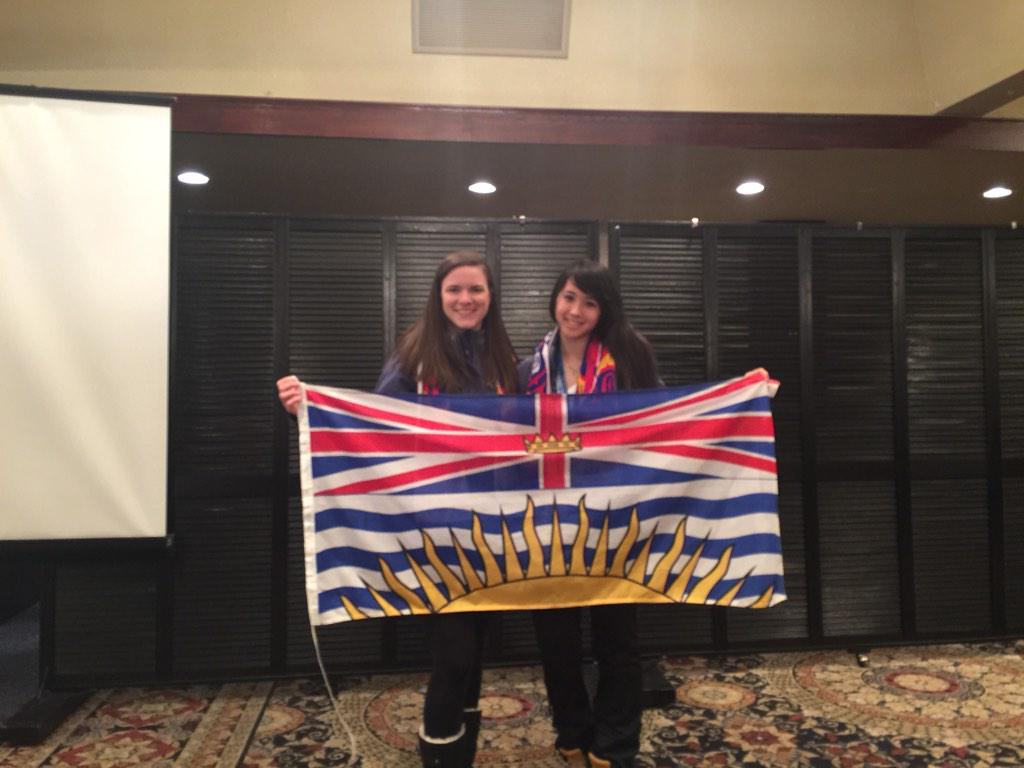 Michèle receives flag from closing ceremonies of Canada Winter Games