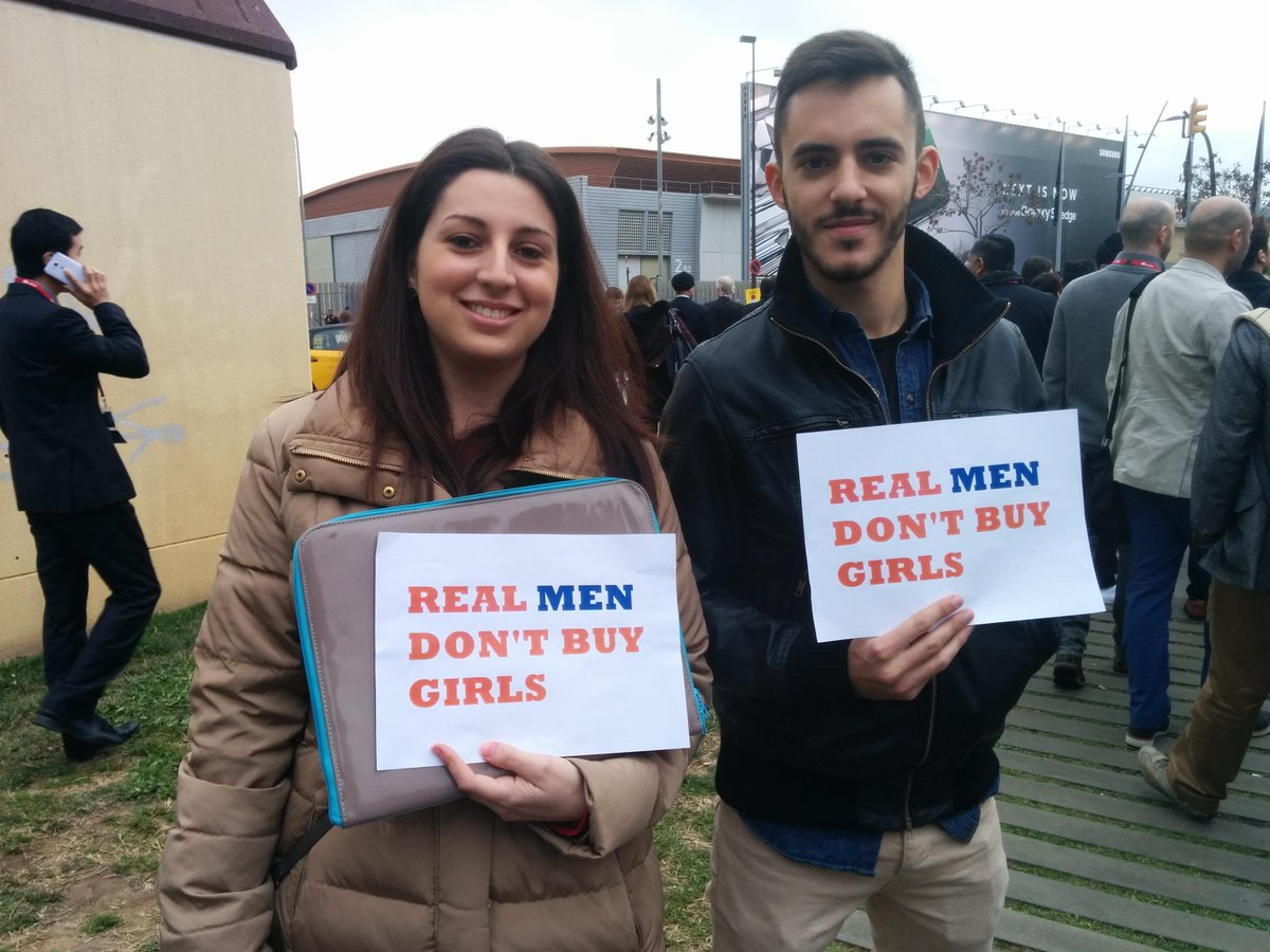 'Real men don't buy girls' #damnright #mwc15 Two of the protesters seen at La Fira this morning. http://t.co/48KQrGVbt5