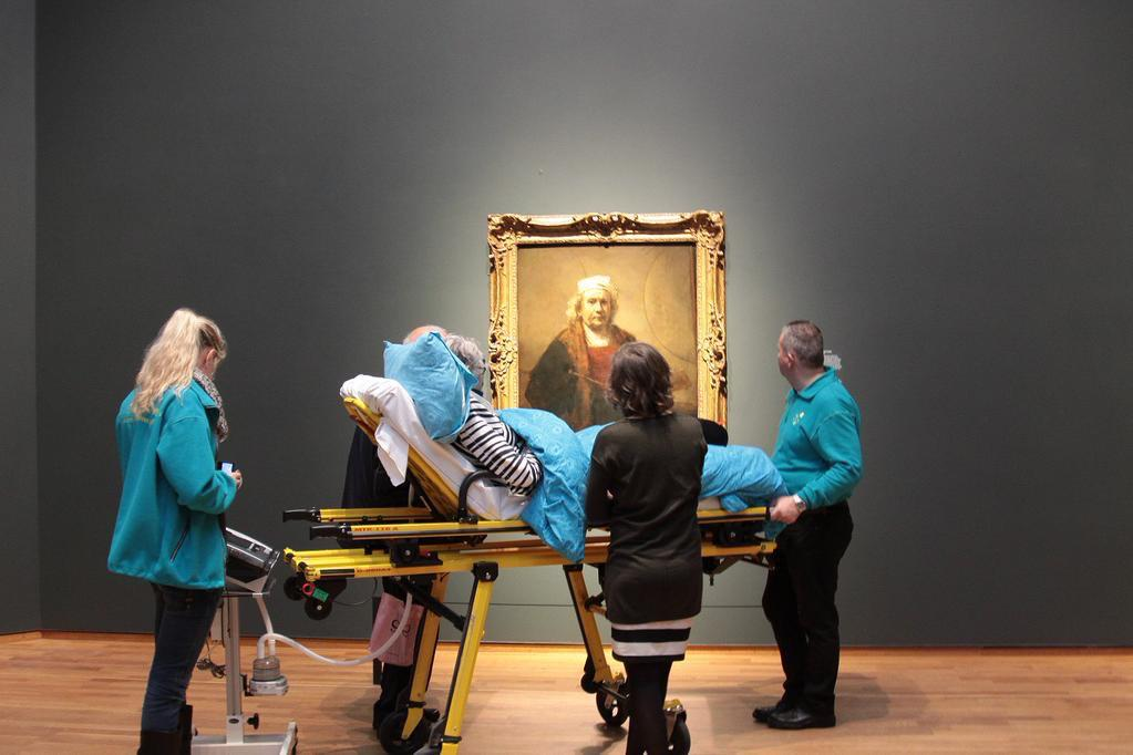 A woman enjoys the @rijksmuseum one last time. http://t.co/5RTLko43O5