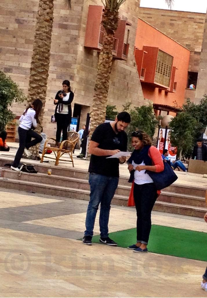 A nice day for class outside: on the #AUC Plaza working w/the #JRMC2202 TSH: @Omarssalem & @nour_eltigani. @JRMCAUC http://t.co/3klcSn7TlN
