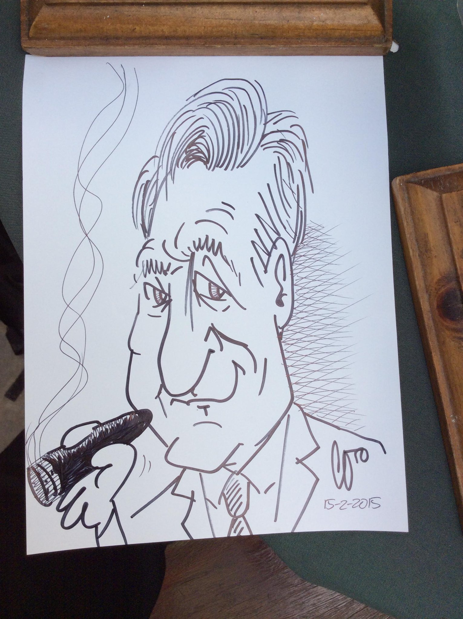 A caricature from a Cuban street artist. At least he got my hair and hand right. #ConanCUBA http://t.co/I1wnOxWMhB