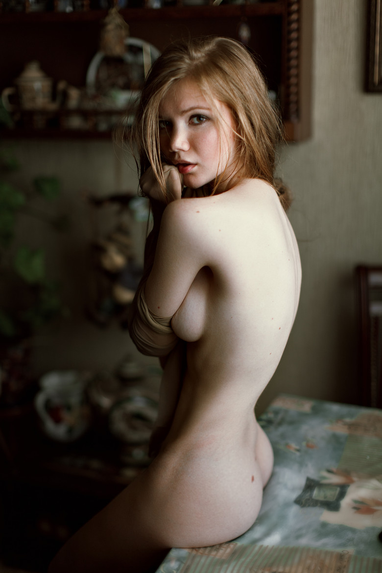 thin and black bent over nude
