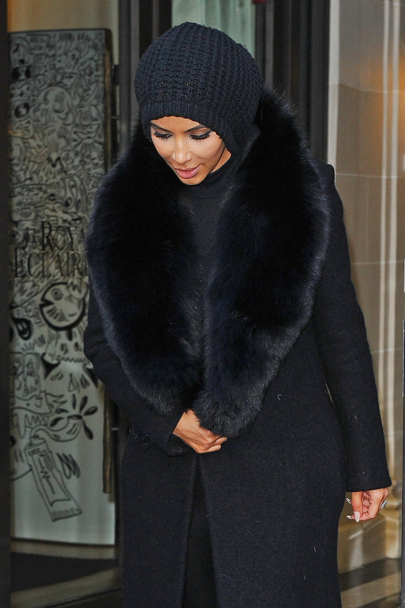 There's something hiding under #KimKardashian's beanie! http://t.co/YdSPCRSfIo http://t.co/SsZJkOciQp