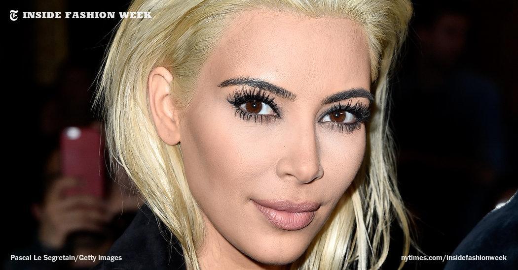 Kim Kardashian shows off a new look at Paris Fashion Week. http://t.co/76IOCGELG9 http://t.co/mqT2ozDBOv