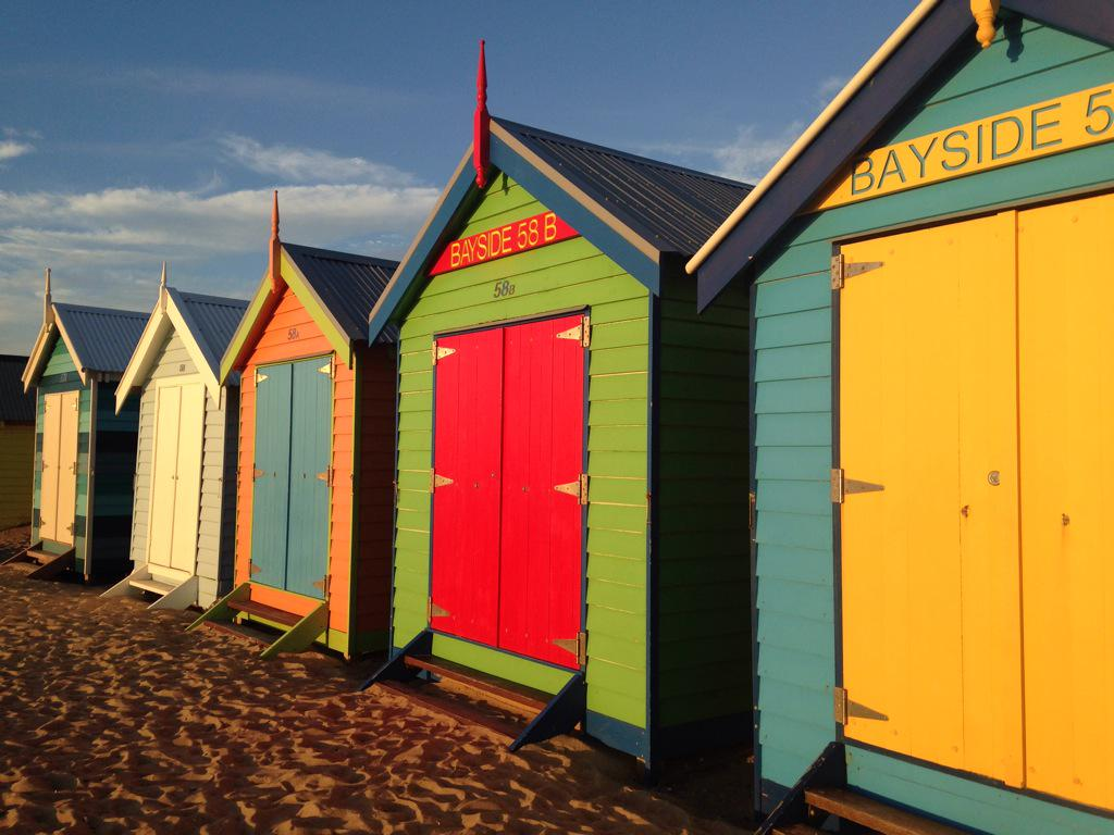 Multi-colored bike sheds on the beach in Melbourne.