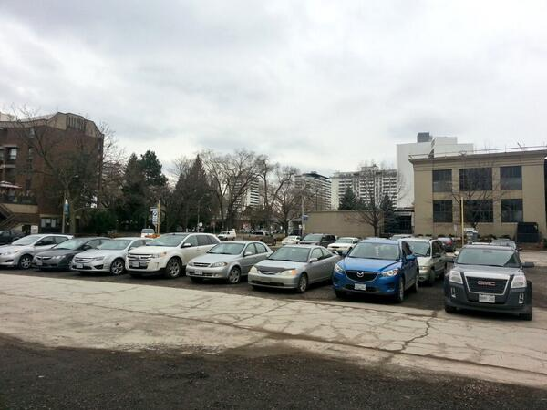 Cars parked on the footprint of the demolished building at 20 Jackson Street West (RTH file photo)
