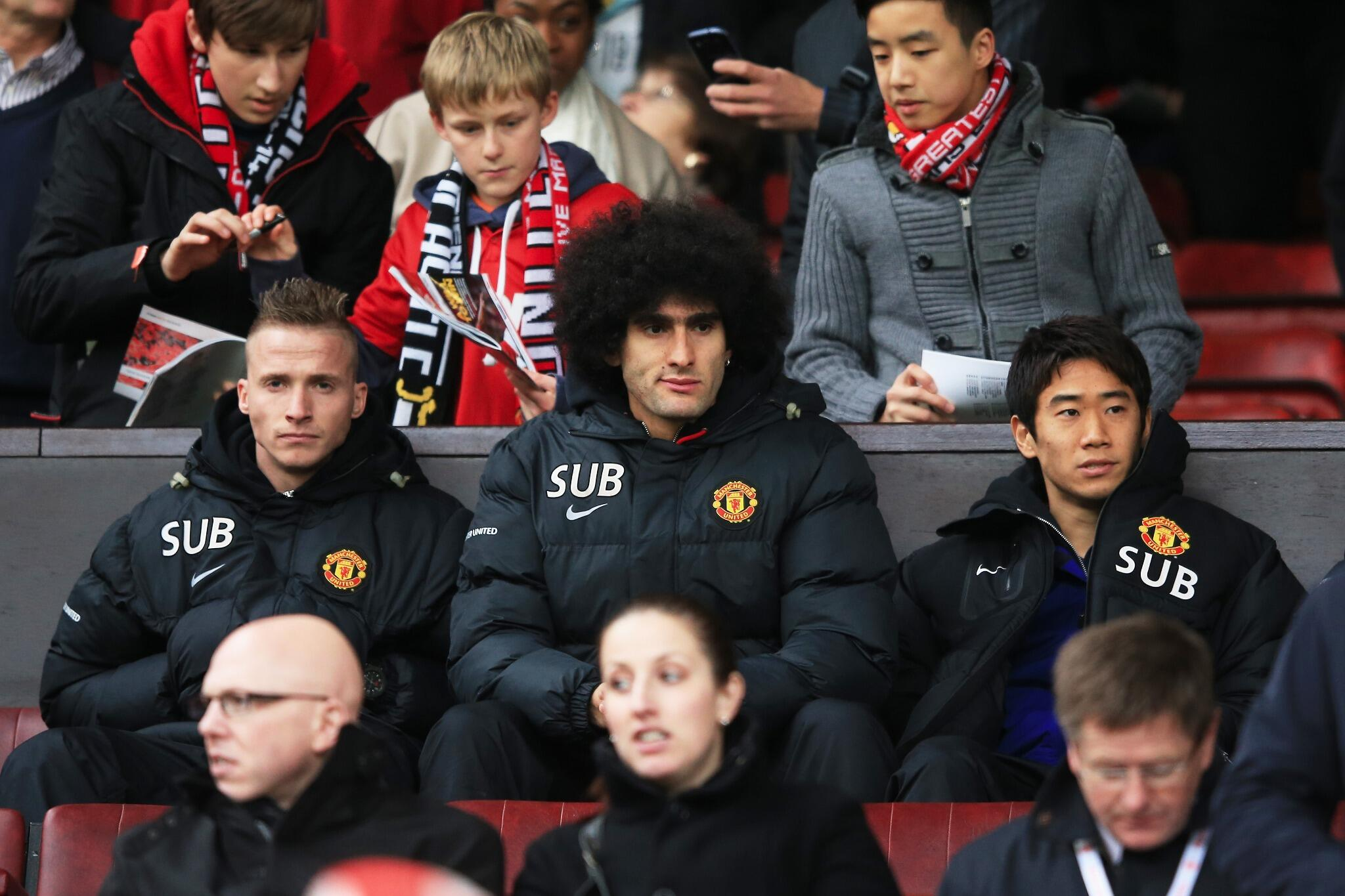 Young Man United fans flicking stuff in Marouane Fellainis hair on the United bench!