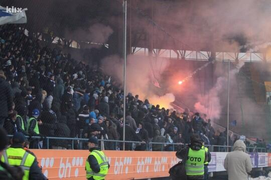 A match in Bosnia was turned into a war zone as fans hurled exploding missiles at each other