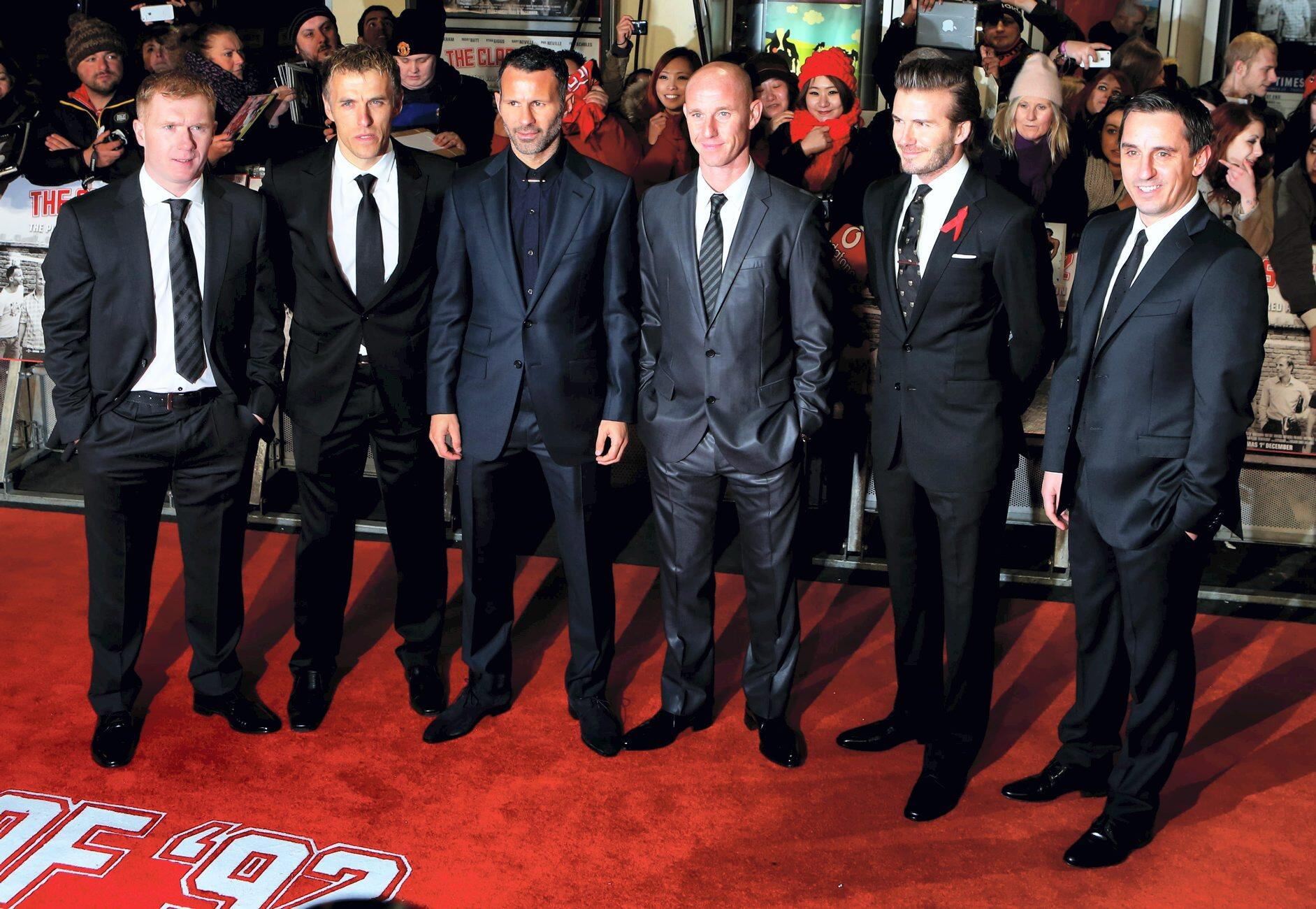 Looking sharp! A suited up Class of 92 pose for a photo on the red carpet