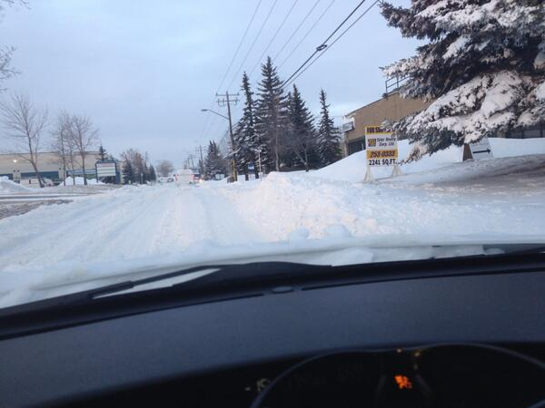 Me thinks a @calgarytransit bus won't be stopping here today. Big drifts in the NE. #yycblizzard http://t.co/331V62rF51