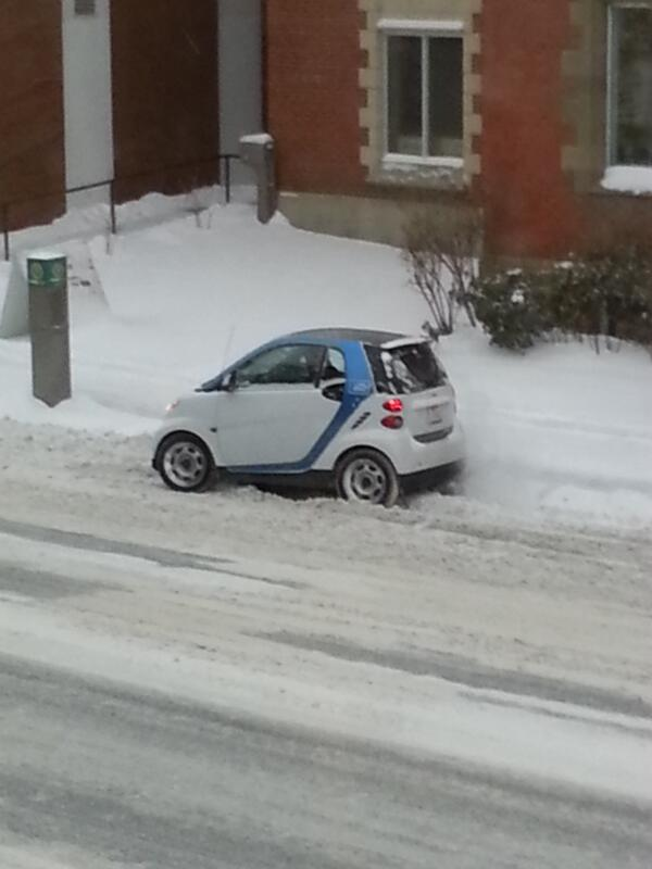 This @car2goCalgary was stuck but this guy rocked back and forth in his seat and got out!  #dedication #yycblizzard http://t.co/hrbVARGc9S