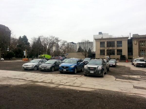 Cars are clearly parked directly on the site of the building