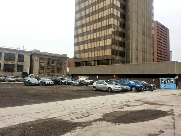 Cars parked on the site of the demolished building at 20 Jackson Street West